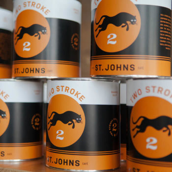 Paint can coffee bean packaging featuring the 2Stroke logo.