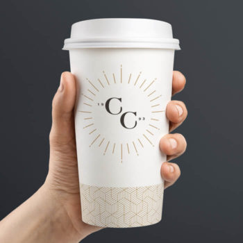 A disposable coffee cup featuring the Coffee Culture emblem.