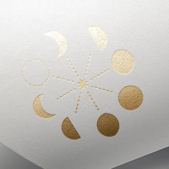 Gold letter pressed moon phase logo of Thread